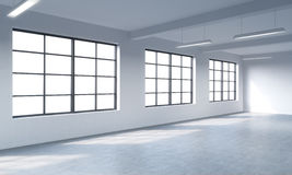 Modern bright clean interior of a loft style open space. Huge windows and white walls. Copy space the panoramic windows. Royalty Free Stock Image