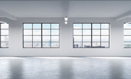 Modern bright clean interior of a loft style open space. Huge windows and white walls. New York panoramic city view. Royalty Free Stock Photo