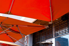 Modern bright orange awning with stainless steel tube stock photography