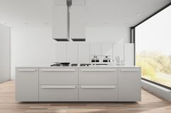 Modern bright white fitted kitchen Royalty Free Stock Images