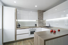 Modern, bright white kitchen with a simple design royalty free stock photos