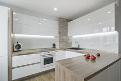 Modern, bright white kitchen with a simple design. Interior in white and light, modern kitchen equipment with a clean and harmonious line Stock Images