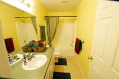 Modern Yellow Bathroom. Modern bright yellow painted bathroom with tub and sink Stock Image