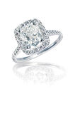 Modern Brilliant cushion Cut halo style diamond ring Stock Photos