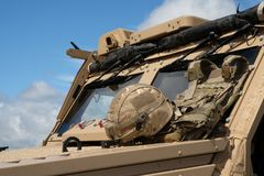 Modern British military vehicle. Modern British military vehicle in detail with soldiers helmet and desert camoflage stock images