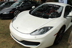 Modern british super sports car. Frontend belonging to McLaren MP4-12C supercar at car show Stock Photos