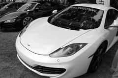 Modern british super sports car. Frontend belonging to McLaren MP4-12C supercar at car show. black and white Royalty Free Stock Image