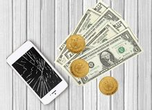 Modern broken mobile phone and dollars on white wooden. Background royalty free stock photos
