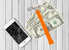 Modern broken mobile phone, hammer and dollars on white Royalty Free Stock Photo