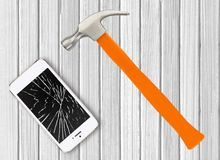 Modern broken mobile phone and hamster on white wooden. Background royalty free stock photos