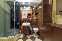 Modern brown and beige bathroom Royalty Free Stock Images