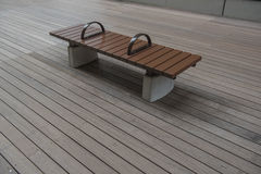 Modern Brown bench on Wooden floor , outdoor Royalty Free Stock Photography