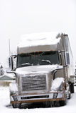 Modern brown Big Rig in winter weather with ice and snow Royalty Free Stock Images