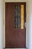 Modern brown metal door openwork with peaks a beautiful vintage background Stock Photo