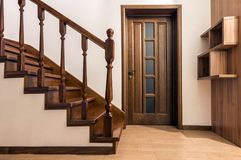 Modern brown oak wooden stairs and doors in new renovated house. Interior stock photos