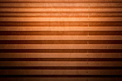 Modern and brown pleated blinds, texture with shadows royalty free stock images