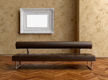 A modern brown sofa and painting on the wall Royalty Free Stock Photography
