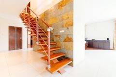 Modern brown wooden stairs. With balustrade in hall Stock Images