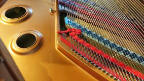 Grand piano open showing strings royalty free stock photo