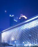 Modern building. It is a night view of modern building, with blue background and moon in the sky. it is the music hall building. The location is in ShenZhen of Royalty Free Stock Image