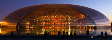 Modern building. Many photographers shoot National Grand Theater of China in evening Royalty Free Stock Photography