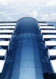 Modern building. Against cloudy sky background stock photos