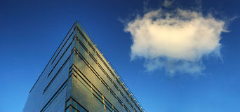 Modern building. With blue sky and cloud Stock Image