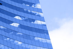 Modern building. Ray on modern building glass wall Stock Images