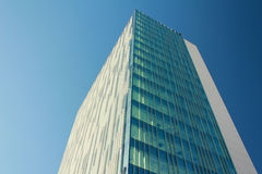 Modern building. Image of skyscraper with blue sky in the background Royalty Free Stock Photography