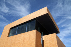 Modern Building. A modern brick building reaching into the blue sky Royalty Free Stock Image