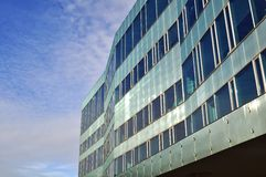 Modern building. Made by steel and glass with a blue sky background Stock Photo