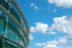 Modern building. Round modern building on a background blue sky royalty free stock images