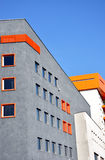 Modern building. Gray an white modern building with orange details Royalty Free Stock Photo