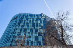 Modern building. Modern blue glass bulding in Bucharest, Romania Royalty Free Stock Photos
