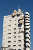 Modern building. Modern palace with antennas parabola sat and balconies Royalty Free Stock Photo