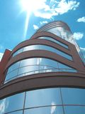 Modern building. The modern building in solar weather, in windows is reflected the blue sky Royalty Free Stock Photos