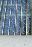 Modern building. It is a girl and the modern buiilding. the building is shenzhen library Stock Photography