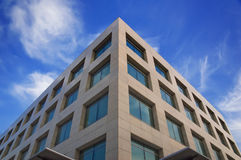 Modern building. High modern building on a background of the blue sky stock photography