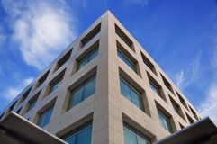 Modern building. High modern building on a background of the blue sky stock photos