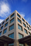 Modern building. High modern building on a background of the blue sky royalty free stock image
