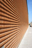 Modern Building. With red bricked wall in perspective royalty free stock image