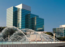 Modern building. With flowing fountain in foreground royalty free stock photos