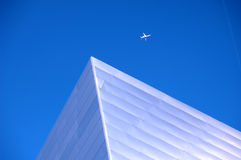 Modern Building 49. Modern building of the future in bright sunlight with jet above Royalty Free Stock Photography