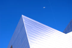 Modern Building 50. Modern building of the future in bright sunlight with jet above Stock Image
