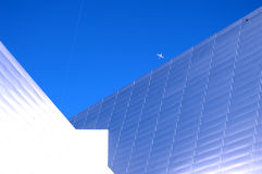 Modern Building 53. Modern building of the future in bright sunlight with jet above Royalty Free Stock Images