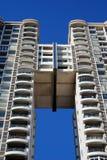 Modern Building. On a bright blue sky Stock Photos