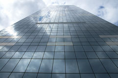 Modern building. A modern building in glass with sky's reflection, Brussels royalty free stock photos