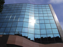 Modern building. Sun reflection in business building Royalty Free Stock Photo