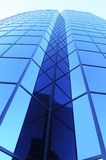 Modern building abstract. Modern office building with blue glass windows Stock Image