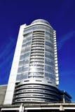 The modern building is against dark blue sky Stock Photos